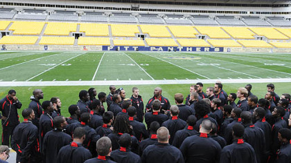 Gardner-Webb coach Ron Dickerson Jr.speaks to his team  at Heinz Field as he leads his team through a walkthrough Friday.