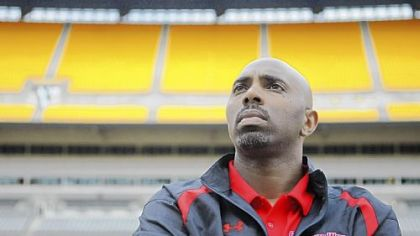 Gardner-Webb coach Ron Dickerson Jr. looks into the stands at Heinz Field on Friday afternoon as he leads his team through a walk-through of the stadium before today's game against Pitt.