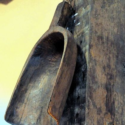 A wooden scoop hangs on a post in the kitchen of the Wise home.