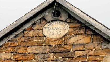 Stones surround the date on the barn near the Wise home.