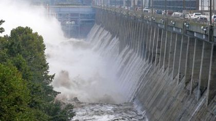 Water rushes through open bays on the Conowingo Dam on the Susquehanna River near Conowingo, Md. Scientists say harmful sediment is making its way through the dam into the Chesapeake Bay, threatening fish and wildlife in the watershed.