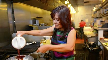 Ling Robinson prepares Queen Tilapia at the Green Mango in Monroeville.
