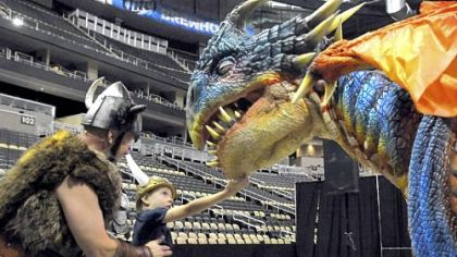 "Sig the Viking shows Caden Suba, 8, of Franklin Park to find the ""soft spot"" of baby dragon Nadder at the ""How to Train Your Dragon Live Spectacular"" preview July at CONSOL Energy Center. The live show ran during the end of August."