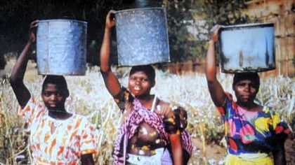 Aubrey Briggs' inspiration for his design, construction and financing a water system for a village in Malawi were the women such as these villagers there who spent their days carrying water on their heads.