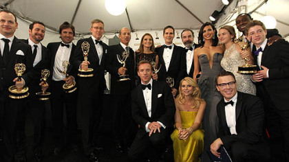 "The cast of ""Homeland"" pose backstage at the 64th Primetime Emmy Awards at the Nokia Theatre on Sunday."