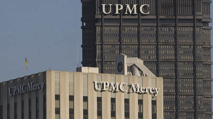 UPMC Mercy  pictured with the  UPMC letters atop of the U.S. Steel Tower in the background.