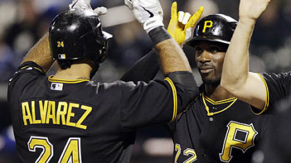 The Pirates' Andrew McCutchen, right, greets Pedro Alvarez at home plate after scoring on Alvarez's first-inning, three-run home run.
