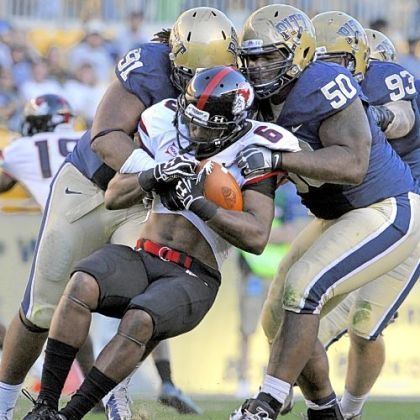Pitt''s Darryl Render and Tyrone Ezell take down Gardner-Webb''s Kenny Little in the third quarter Saturday at Heinz Field.