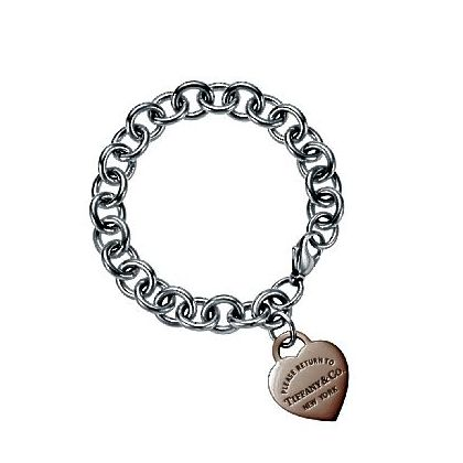 Return to Tiffany heart tag in RUBEDO metal on a sterling silver bracelet chain; $475.