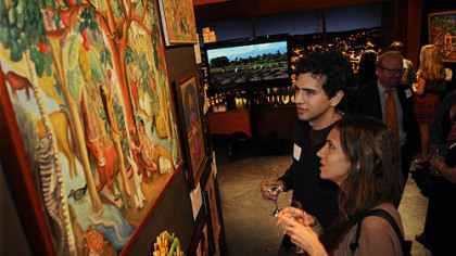 Luke Markiewicz and his sister Tonya Markiewicz look at Haitian art for sale.