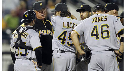 Pirates manager Clint Hurdle talks to starting pitcher Jeff Locke before removing him from the game in the fourth inning. Locke allowed five runs on nine hits in three and two-thirds innings.