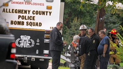 The bomb squad robot is readied to enter a residence on New York Circle in Bridgeville, before a man was found dead in an elaborate suicide.