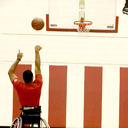 Wheelchair basketball player Trevon Jenifer shoots around at Edinboro University on Friday.