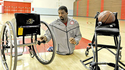 Trevon Jenifer, a 24-year-old graduate of Edinboro University, switches the wheels from his everyday wheelchair to the one he uses for basketball. The game chairs are custom-built to regulation specifications for each player depending on their size and style of play.
