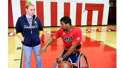 Trevon Jenifer explains game strategy to his girlfriend of nearly four years, Laura Klass.