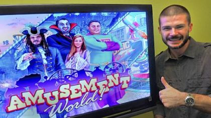 "Matt Rodgers, founder of South Side-based HeadRight Games and creator of ""Amusement World,"" shows a television screen displaying the game."