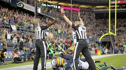 Wide receiver Golden Tate of the Seahawks makes a catch in the end zone to defeat the Packers on a controversial call by the officials.