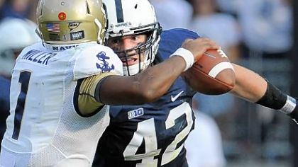Linebacker Michael Mauti zeros in on Navy quarterback Trey Miller Saturday. He would later seal the win with a 74-yard return of a fumble in Penn State's 34-7 victory against the Midshipmen at Beaver Stadium.