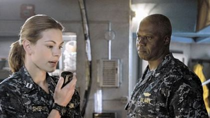 "Andre Braugher, right, portrays a rogue captain of a submarine whose crew includes Daisy Betts in ABC's ""Last Resort."""