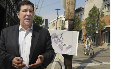 City Councilman Bill Peduto in August talked about the bike corrals -- cordoned-off areas where riders can park their bikes -- that are to be installed along Walnut Street in Shadyside.