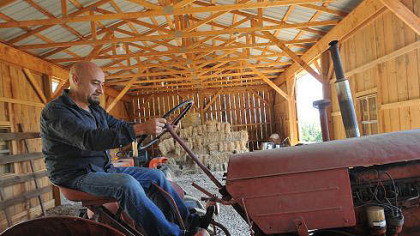 Nick DiCio fires up an antique tractor that will be used to pull a wagon for hayrides at the first annual Pepper Farm Festival.