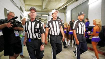 From left, officials Bob Waggoner, Gene Steratore of Washington, Pa., and Wayne Mackie, walk toward the field before Thursday's game between the host Baltimore Ravens and Cleveland Browns.