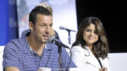 "Adam Sandler, left, and Selena Gomez answer questions about ""Hotel Transylvania"" at the Toronto International Film Festival."