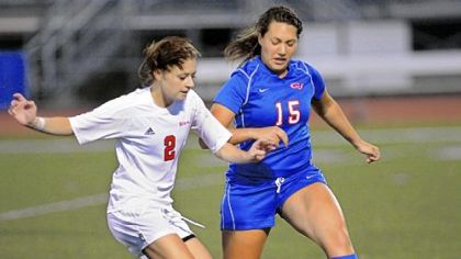 Peters Township midfielder Nicole Hume, left, fights for possession with Chartiers Valley defender Alanna Sullivan Sept. 19.