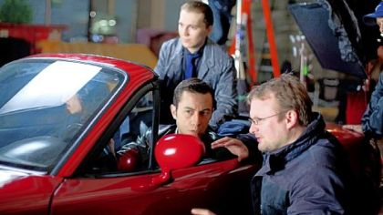 "Rian Johnson, right, directs Joseph Gordon-Levitt on the set of ""Looper."""