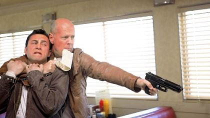 "Joseph Gordon-Levitt, left, and Bruce Willis play the same character in ""Looper."""