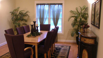 The dining room at Park Place - Cranberry has Craftsman-style trim and crown molding.