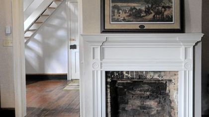 The living room fireplace and mantel at Church  Street in Ambridge.