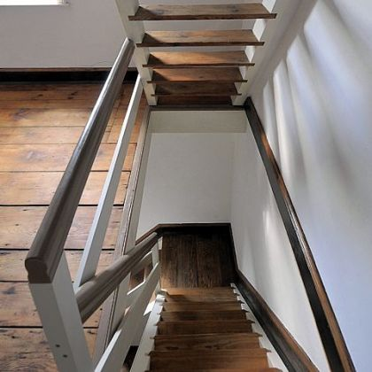 Restored open stairway in Church Street home.