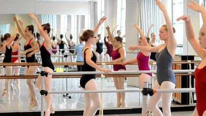Ballet students practice Wednesday at the Lincoln Park Performing Arts Charter School in Midland.