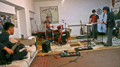 "Mohanik in their practice space going over ""Johnny B. Goode"" before a performance, From left: Enerelt, Bagi, Dawaa, Tsojo."