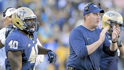 Pitt's Dan Mason watches next to head coach Paul Chryst after his team recovered a fumble against Gardner-Webb in the fourth quarter.