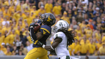 West Virginia's Stedman Bailey hauls in a 47-yard touchdown pass in front of Baylor's K.J. Morton in the second quarter. It was the first of five touchdown passes he would catch to go with 303 yards receiving.