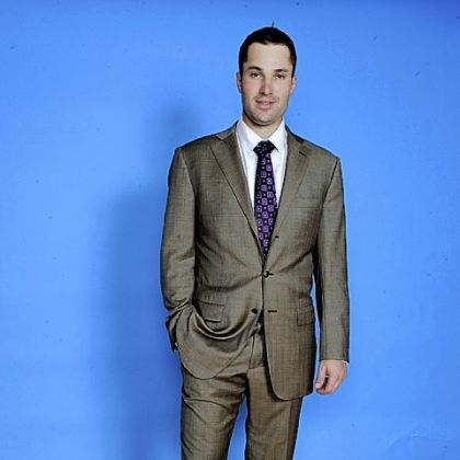 The Pirates' Neil Walker models a suit from Astor & Black.