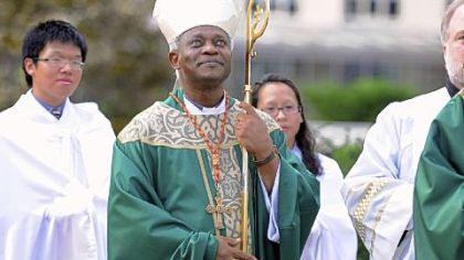 Cardinal Peter Turkson takes part in a processional for Mass at Duquesne University&#039;s Chapel of the Holy Spirit on Saturday.