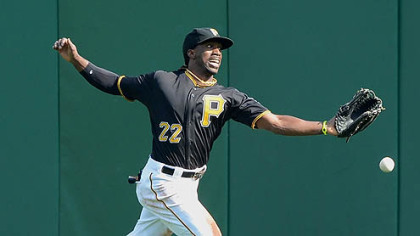 Pirates center fielder Andrew McCutchen cannot run down a ball hit by the Reds' Miguel Cairo for a double.