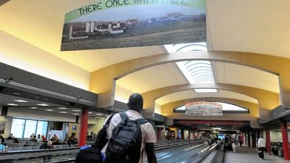Travelers walk through the terminal at Pittsburgh International Airport, which opened 20 years ago.