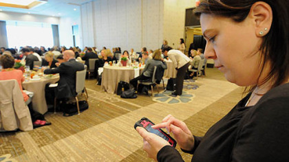 Amie Downs, Allegheny County Executive Rich Fitzgerald's communications director, tweets from  a real estate talk  at the Fairmont Pittsburgh hotel.