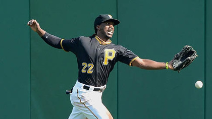 Pirates center fielder Andrew McCutchen cannot run down a ball hit Sunday by the Reds' Miguel Cairo for a double.