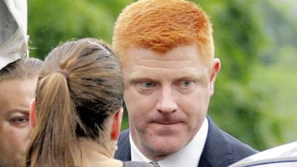 Penn State University assistant football coach Mike McQueary arrives at the Centre County Courthouse to testify in the child sexual abuse trial of former Penn State University assistant football coach Jerry Sandusky in Bellefonte, Pa., Tuesday, June 12, 2012.
