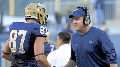 Pitt head coach Paul Chryst congratulates Mike Shanahan after scoring a touchdown against Gardner-Webb Sept. 22 at Heinz Field.