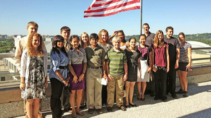 "2012 Student Ambassadors pose on the private balcony of the State Department Building in Washington D.C. The students in the ""I want to be an ambassador!"" program were given a private tour of the historic Diplomatic Reception Rooms in June."