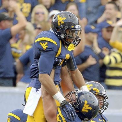 West Virginia wide receiver Stedman Bailey celebrates with his teammates in the fourth quarter of Saturday&#039;s 70-63 victory against Baylor.