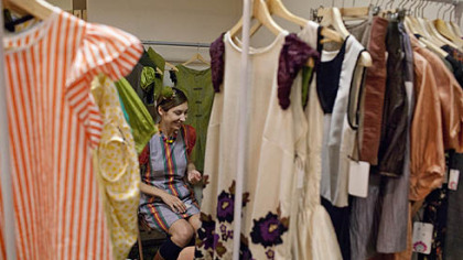 Monika Gibson, owner of the line Zuza Blue, sits in her booth at the Fashion Ave. Vendors Fair.