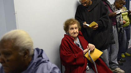 Sophie Masloff, 94, of Squirrel Hill, a former mayor of Pittsburgh, waits in line with others for voter identification Monday evening at the CCAC Homewood-Brushton Center. A judge ruled this morning to toss out a portion of the law.