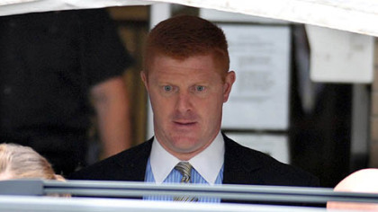 Mike McQueary, a Penn State assistant football coach who is currently on leave, exits the Centre County Courthouse on June 12, 2012 after testifying for two hours.